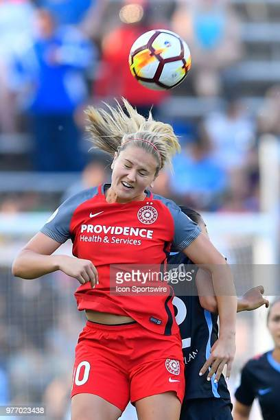 Portland Thorns FC's Lindsey Horan heads the ball over Chicago Red Stars's Yki Nagasato on June 16 2018 at Toyota Park in Bridgeview Illinois