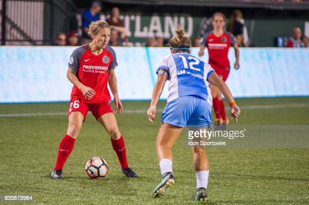 Portland Thorns forward Mallory Weber looks for a pass marked by Houston Dash defender Amber Brooks during the second half of the Portland Thorns 20...