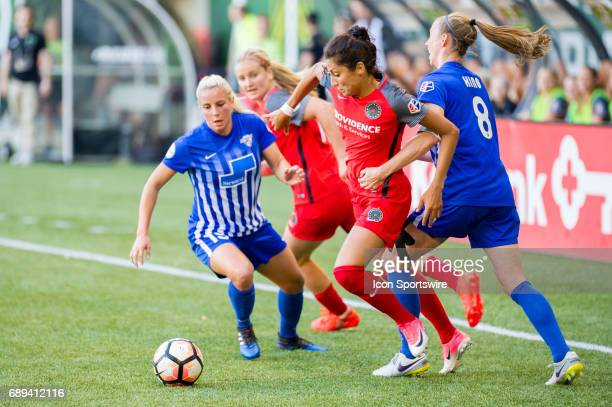Portland Thorns forward Nadia Nadim dribbles past Boston Breakers defender Julie King and midfielder Adriana Leon during the first half of the...