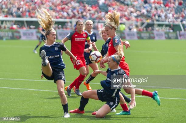 Portland Thorns midfielder LIndsey Horan controls a pass while marked by three Seattle Reign defenders during the Seattle Reign 32 win over the...