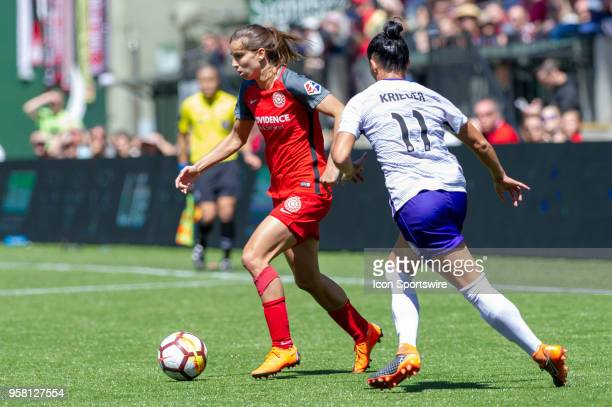 Portland Thorns midfielder Tobin Heath dribbles past Orlando Pride defender Ali Krieger during an NWSL soccer match between the Portland Thorns and...