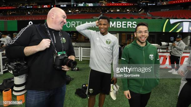 Portland Timbers Alvas Powell and team photographer Craig Mitchelldyer and press officer Kevin Acevedo during the MLS Cup 2018 Team Training Sessions...