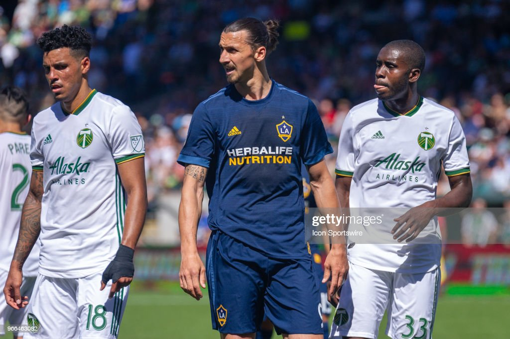 Portland Timbers center defenders Julio Cascante (18) and Larrys Mabiala (33) keep a close eye on LA Galaxy forward Zlatan Ibrahimovic during the 1-1 draw of the LA Galaxy and the Portland Timbers on June 2, 2018, at Providence Park, Portland, OR (Photo by Diego Diaz/Icon Sportswire via Getty Images).