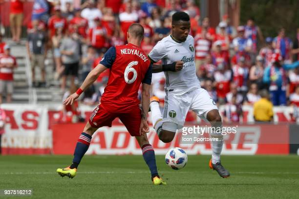 Portland Timbers defender Alvas Powell and FC Dallas defender Anton Nedyalkov battle for a loose ball during the soccer match between the Portland...
