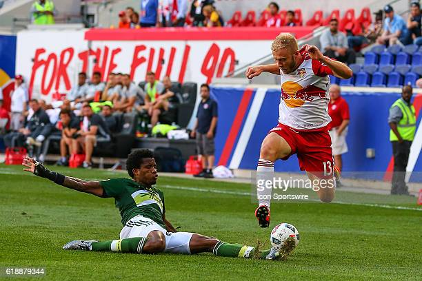 Portland Timbers defender Alvas Powell knocks the ball away from New York Red Bulls forward Mike Grella during the first half of the game between the...