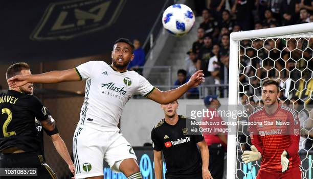 Portland Timbers midfielder Diego Chara eyes the ball as Los Angeles FC goalkeeper Tyler Miller looks on in the first half of a Major league Soccer...