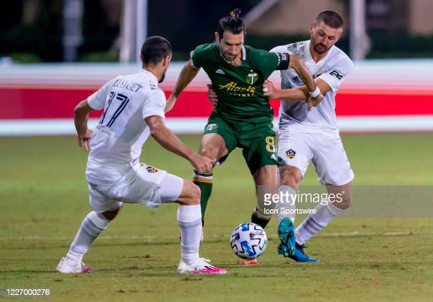 Portland Timbers midfielder Diego Valeri gets fouled during the MLS Is Back Tournament between the LA Galaxy v Portland Timbers on July 13 2020 at...