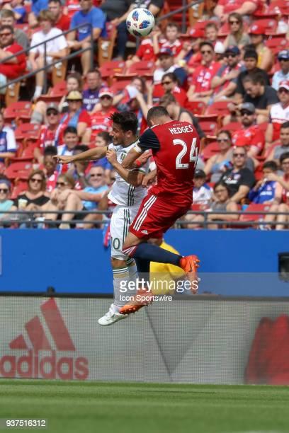 Portland Timbers midfielder Sebastian Blanco and FC Dallas defender Matt Hedges battle for a header during the soccer match between the Portland...