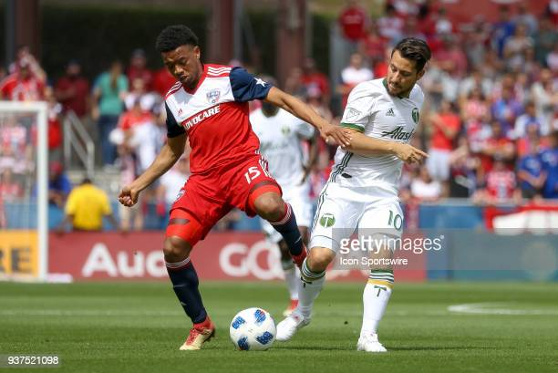 Portland Timbers midfielder Sebastian Blanco and FC Dallas midfielder Jacori Hayes battle for control of the ball during the soccer match between the...