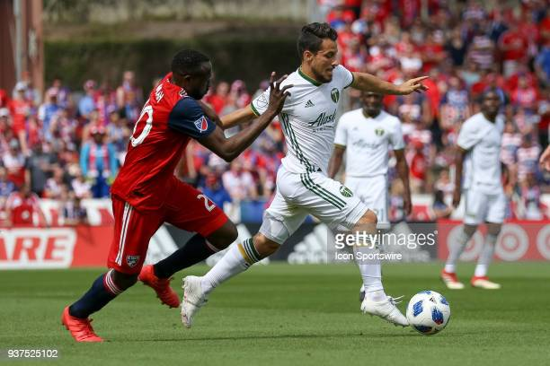 Portland Timbers midfielder Sebastian Blanco fights off FC Dallas forward Roland Lamah while handling the ball during the soccer match between the...