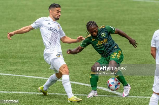 Portland Timbers midfielder Yimmi Chará dribbles LA Galaxy midfielder Sebastian Lletget during the Portland Timbers MLS match versus the LA Galaxy on...