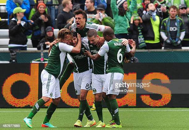 Portland Timbers teammates mob Diego Valeri of Portland Timbers after Valeri scored a goal during the first half of the game against the Seattle...