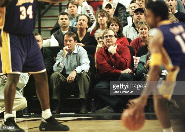 Portland Trail Blazer team owner Paul Allen watches from his courtside seat along with team president and general manager Bob Whitsitt during second...