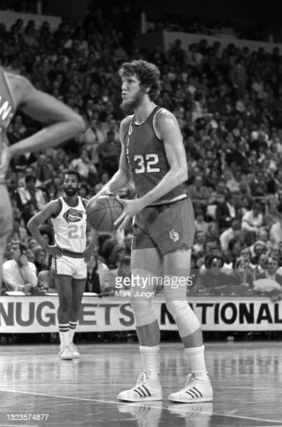 Portland Trail Blazers center Bill Walton collects himself prior to a free throw during an NBA basketball game against the Denver Nuggets at...