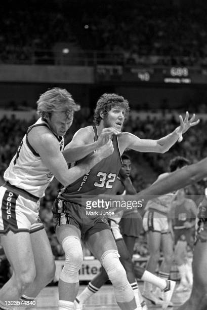 Portland Trail Blazers center Bill Walton elbows Denver Nuggets center Dan Issel during an NBA basketball game at McNichols Arena on January 26, 1977...