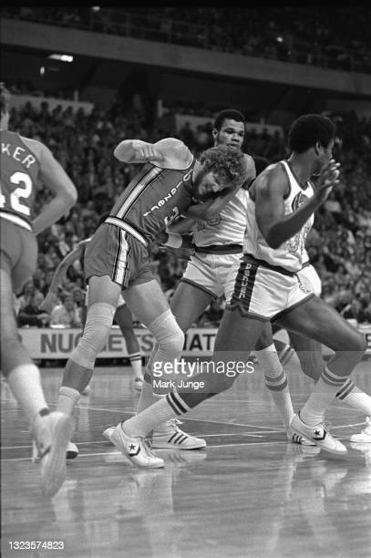 Portland Trail Blazers center Bill Walton pushes against Denver Nuggets center Marvin Webster for position during an NBA basketball game at McNichols...