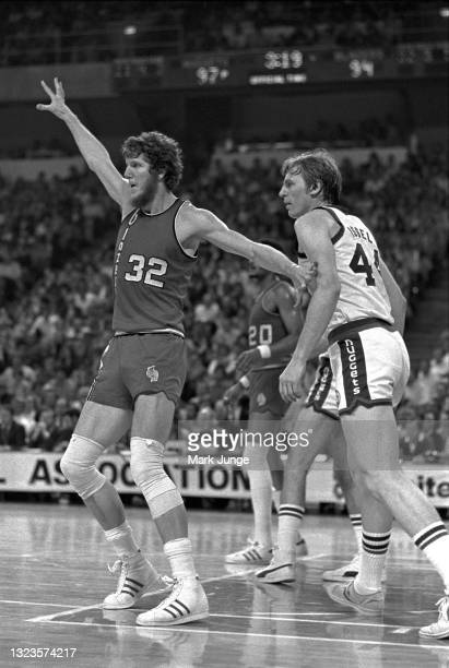 Portland Trail Blazers center Bill Walton pushes off from Denver Nuggets center Dan Issel during an NBA basketball game at McNichols Arena on January...