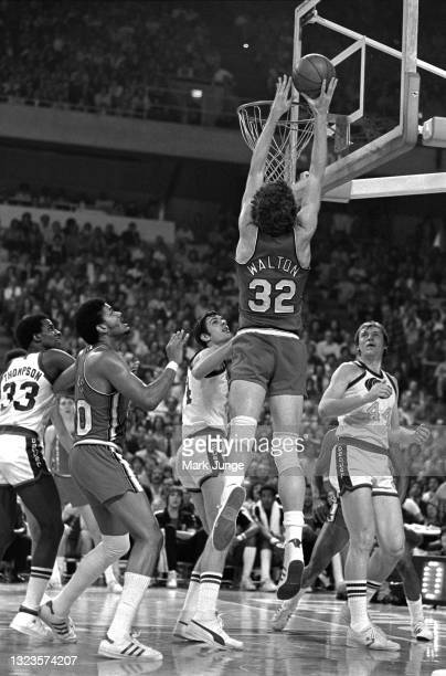 Portland Trail Blazers center Bill Walton reaches for the ball over the rim during an NBA basketball game against the Denver Nuggets at McNichols...