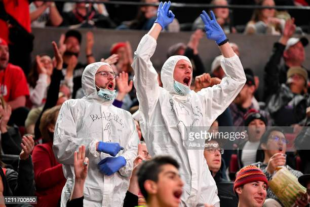 Portland Trail Blazers fans wear Coronavirus protective suits during the game against the Phoenix Suns at the Moda Center on March 10 2020 in...