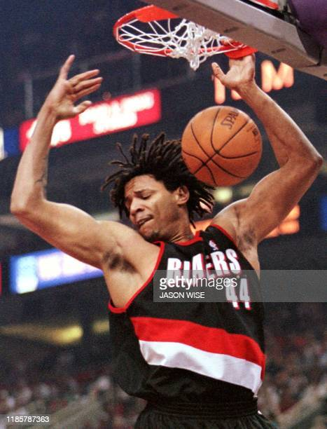 Portland Trail Blazers forward Brian Grant follows through on a slam dunk against the Phoenix Suns in game three of their first round NBA Western...