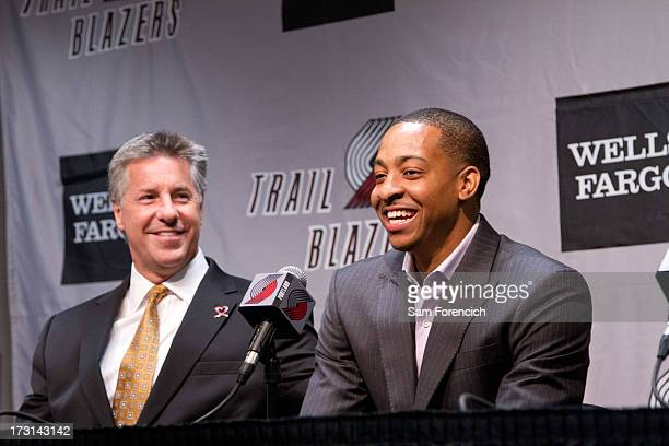 Portland Trail Blazers General Manager Neil Olshey looks on as NBA draft pick CJ McCollum of the Portland Trail Blazers is introduced to the local...
