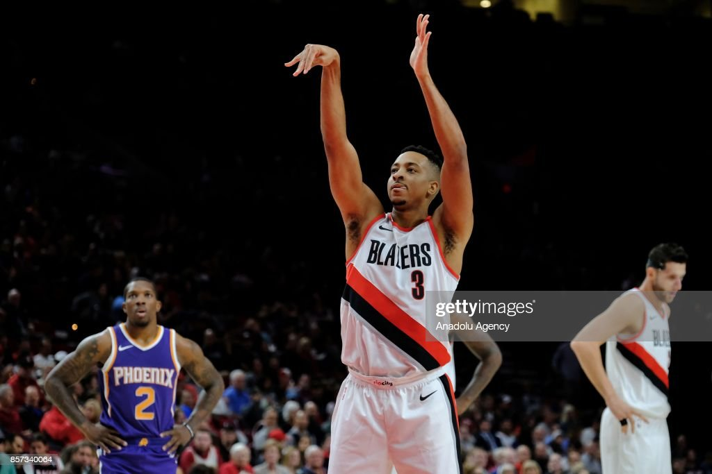 Portland Trail Blazers guard CJ McCollum (3) shoots during the preseason game against the Phoenix Suns in Portland, Ore., United States, on October 2, 2017.