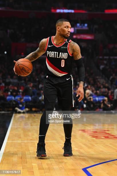 Portland Trail Blazers Guard Damian Lillard brings the ball up the court during a NBA game between the Portland Trail Blazers and the Los Angeles...