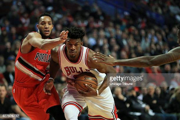 Portland Trail Blazers guard Evan Turner and forward AlFarouq Aminu guard Chicago Bulls forward Jimmy Butler during the first half on Monday Dec 5...