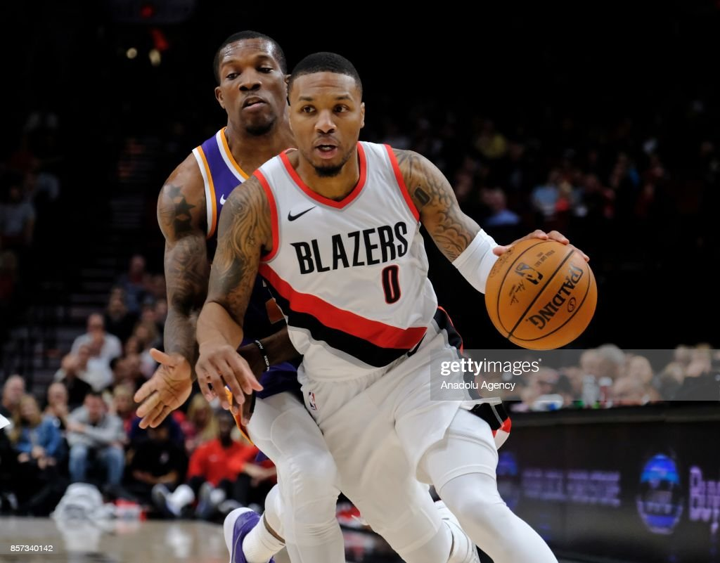 Portland Trail Blazers guard guard Damian Lillard (0) breaks away during the preseason game against the Phoenix Suns in Portland, Ore., United States, on October 2, 2017.