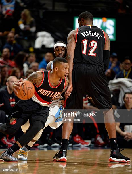 Portland Trail Blazers guard Wesley Matthews drives around teammate Portland Trail Blazers forward LaMarcus Aldridge he he puts a pick on Denver...