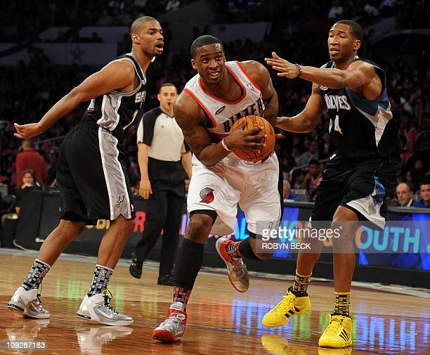 Portland Trail Blazers guard Wesley Matthews of the Sophmore team drives to the basket against Rookie team members San Antonio Spurs guard Gary Neal...