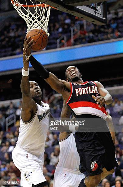 Portland Trail Blazers guard Wesley Matthews shoots around Washington Wizards power forward Andray Blatche during their game played at the Verizon...