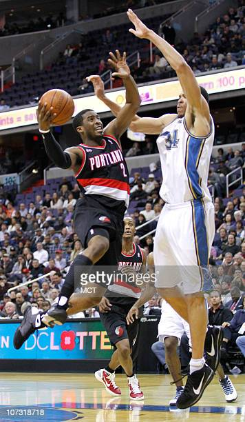 Portland Trail Blazers guard Wesley Matthews tries to get a shot over Washington Wizards center JaVale McGee during their game played at the Verizon...