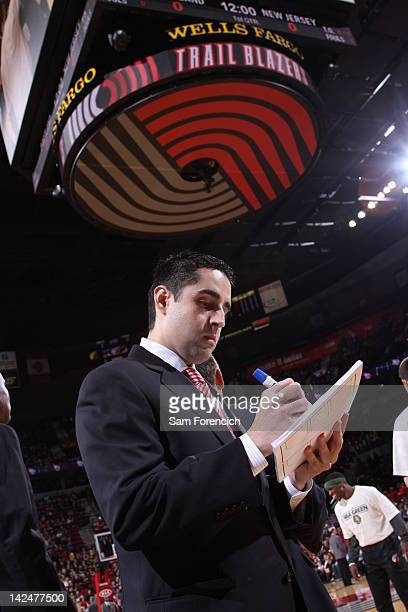 Portland Trail Blazers head coach Kaleb Canales diagrams a play against the New Jersey Nets on April 4 2012 at the Rose Garden Arena in Portland...