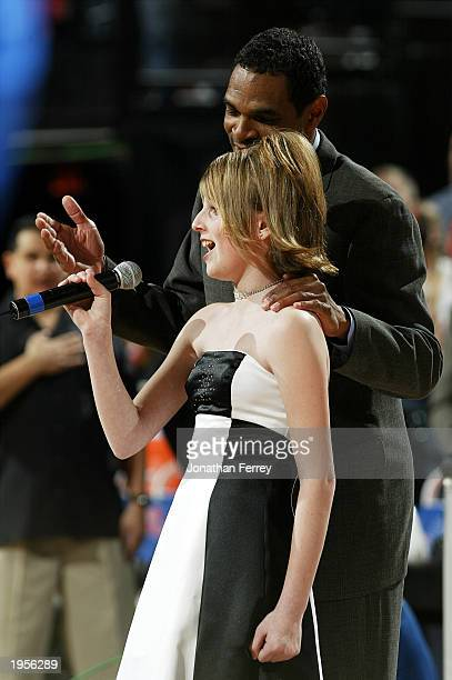 Portland Trail Blazers head coach Maurice Cheeks helps Natalie Gilbert finish singing the national anthem after she before a 2003 Western Conference...