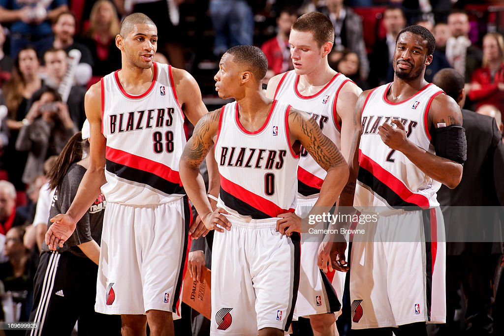 Portland Trail Blazers players, from left, Nicolas Batum #88, Damian Lillard #0, Luke Babbitt #8 and Wesley Matthews #2 wait to resume play against the Milwaukee Bucks on January 19, 2013 at the Rose Garden Arena in Portland, Oregon.