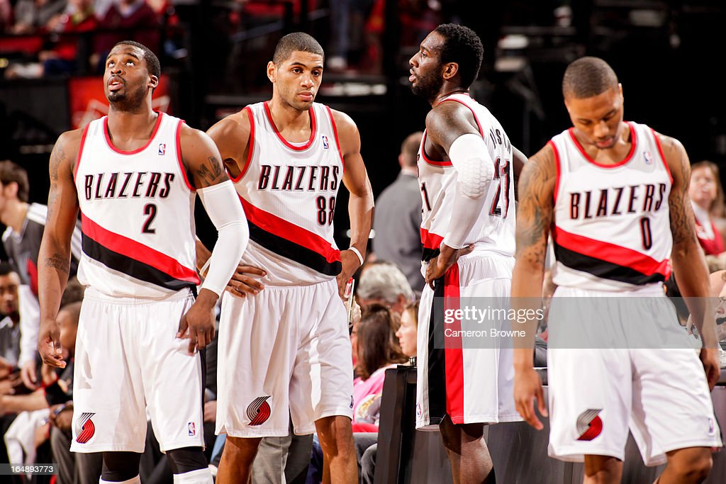 Portland Trail Blazers players, from left, Wesley Matthews #2, Nicolas Batum #88, J.J. Hickson #21 and Damian Lillard #0 look on during a game against the Brooklyn Nets on March 27, 2013 at the Rose Garden Arena in Portland, Oregon.