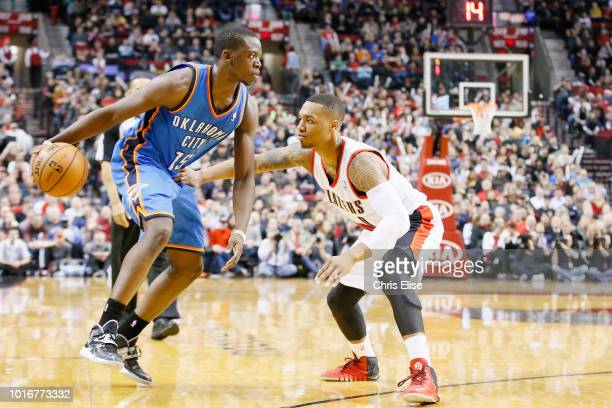 Portland Trail Blazers point guard Damian Lillard defends on Oklahoma City Thunder point guard Reggie Jackson during the Portland Trail Blazers...
