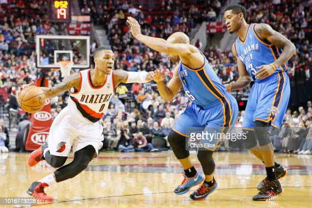 Portland Trail Blazers point guard Damian Lillard drives past Oklahoma City Thunder point guard Derek Fisher during the Portland Trail Blazers 111104...