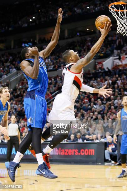 Portland Trail Blazers point guard Damian Lillard goes for the layup past Dallas Mavericks center Bernard James during the Dallas Mavericks 108106...