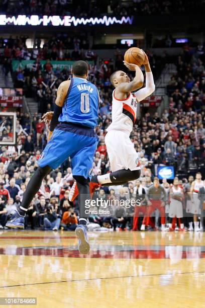 Portland Trail Blazers point guard Damian Lillard makes a late three point jumpshot to tie the game with 19 second remaining over Dallas Mavericks...