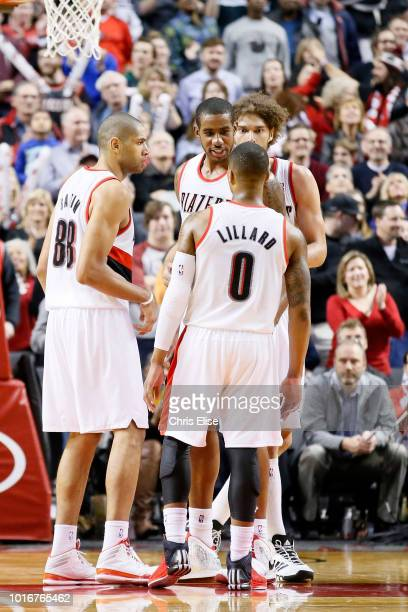 Portland Trail Blazers power forward LaMarcus Aldridge talks to Damian Lillard Nicolas Batum and Robin Lopez during the Portland Trail Blazers 106102...