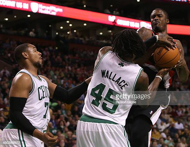 Portland Trail Blazers shooting guard Wesley Matthews and Boston Celtics small forward Gerald Wallace battle for the ball in the second half A jump...