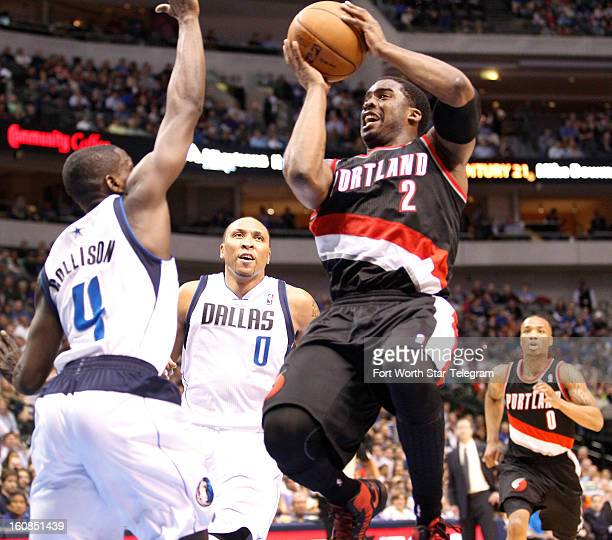 Portland Trail Blazers shooting guard Wesley Matthews shoots over Dallas Mavericks point guard Darren Collison and small forward Shawn Marion in...