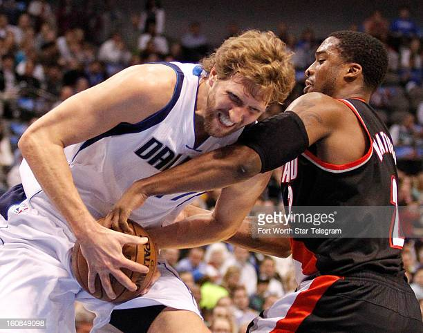 Portland Trail Blazers shooting guard Wesley Matthews tries to stop Dallas Mavericks power forward Dirk Nowitzki during the first quarter in Dallas...