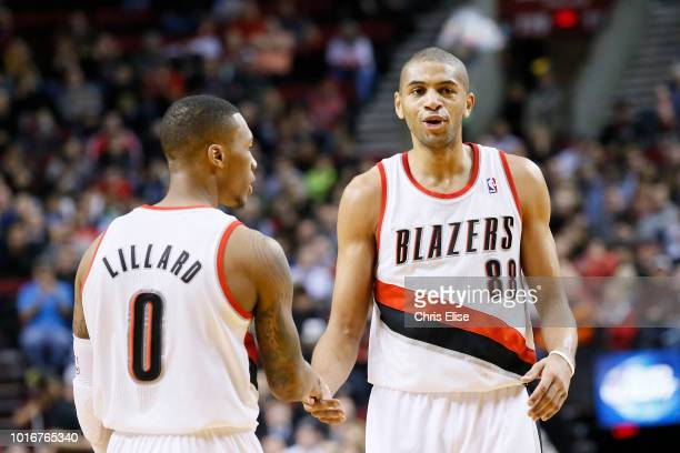 Portland Trail Blazers small forward Nicolas Batum celebrates with Portland Trail Blazers point guard Damian Lillard during the Portland Trail...