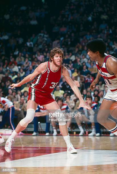 Portland Trailblazers' center Bill Walton eyes down and blocks his opponent during a game against the Washington Bullets at Capital Centre circa 1977...