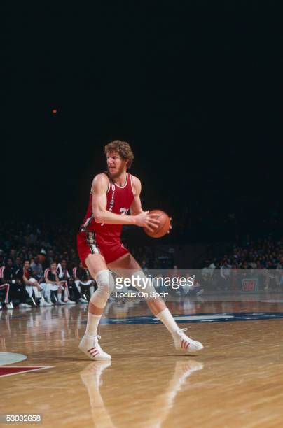 Portland Trailblazers' center Bill Walton looks to pass to a teammate during a game against the Washington Bullets at Capital Centre circa 1977 in...