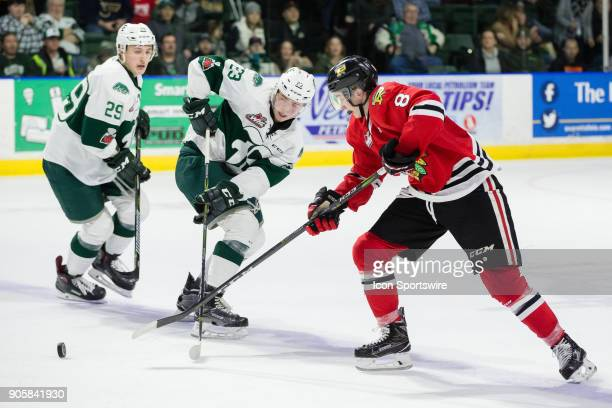 Portland Winterhawks forward Cody Glass gets the puck past Everett Silvertips defenseman Jake Christiansen at the blue line during a game between the...