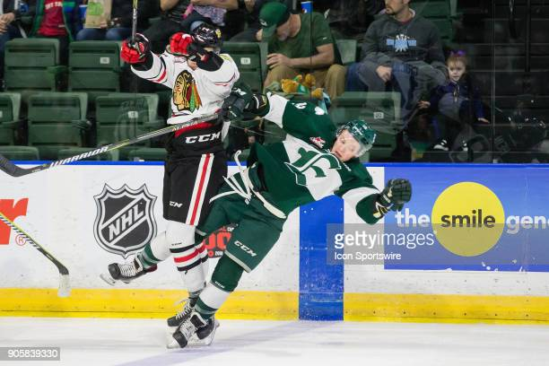 Portland Winterhawks forward Jake Gricius hits Brandson Hein at the blue line during a game between the Everett Silvertips and the Portland...